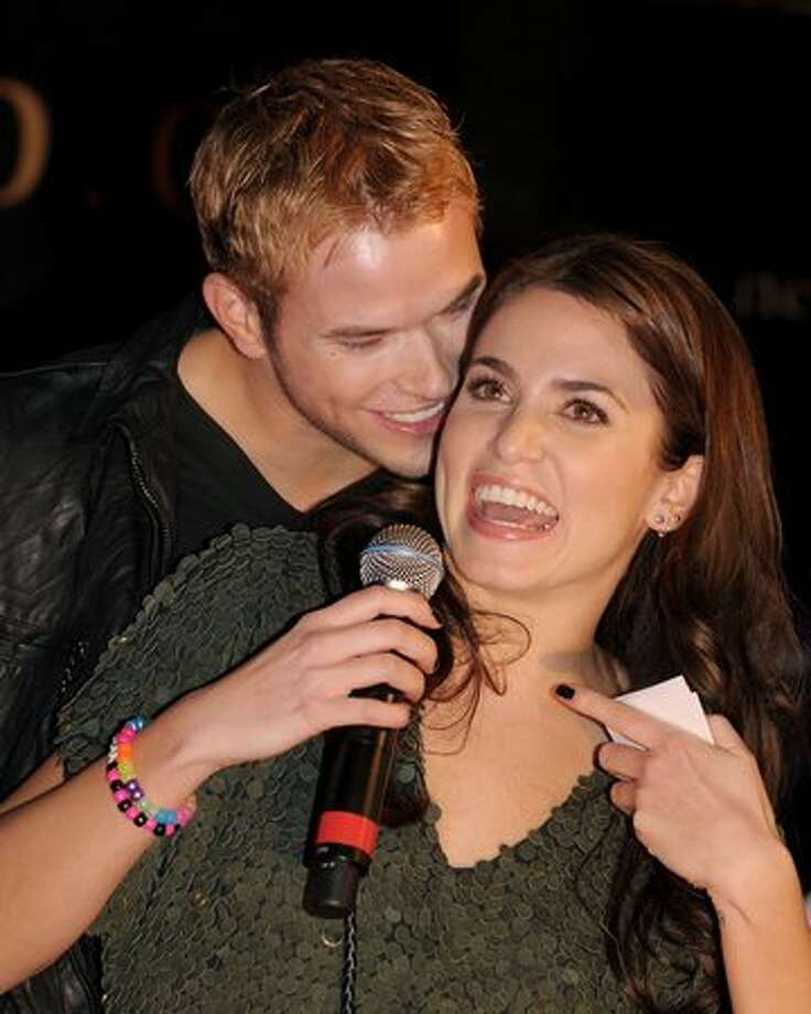 "Actors Kellan Lutz (L) and Nikki Reed appear onstage at Summit's ""The Twilight Saga: New Moon"" Cast Tour at Hollywood and Highland in Los Angeles, California. Photo: Getty Images"