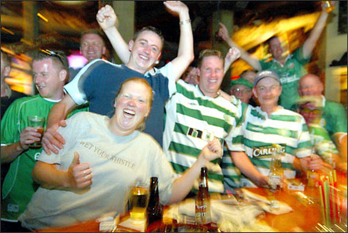 Celtic fans party before the game at the Owl n' Thistle Irish Pub. Their team later lost 4-0.