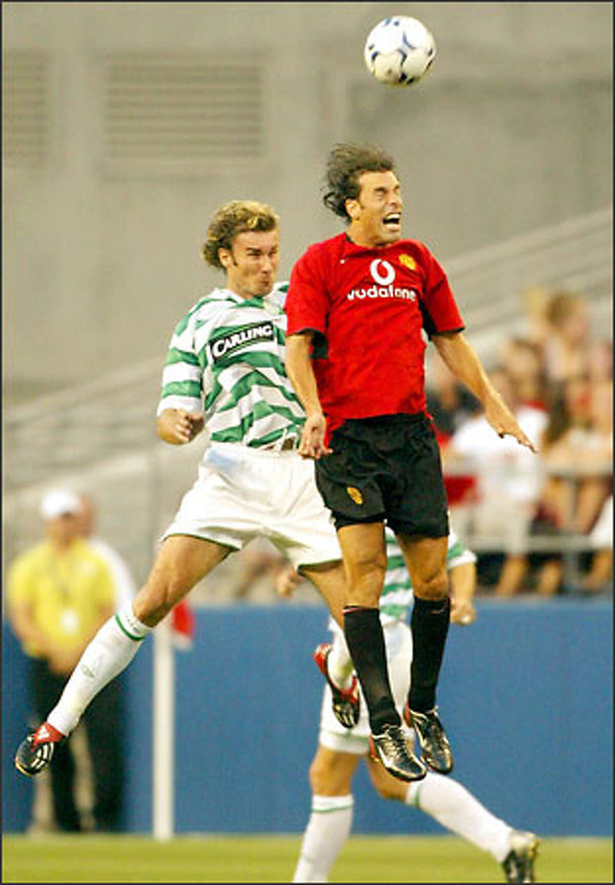 Celtic's Craig Beattie, left, and Manchester United's Ruud van Nistelrooy do their thing during first-half action at Seahawks Stadium. Nistelrooy scored Man U's first goal and set up the second.