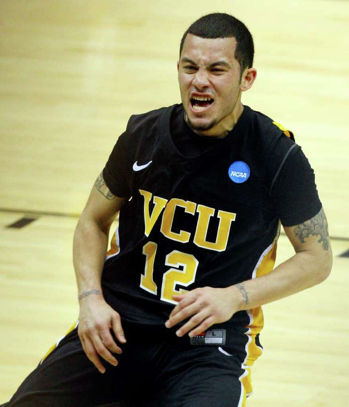 FOR SPORTS - VCU's Joey Rodriguez reacts after his team beat Florida State in overtime of the NCAA Southwest Regional Semifinals Friday March 25, 2011 at the Alamodome. VCU won 72-71.