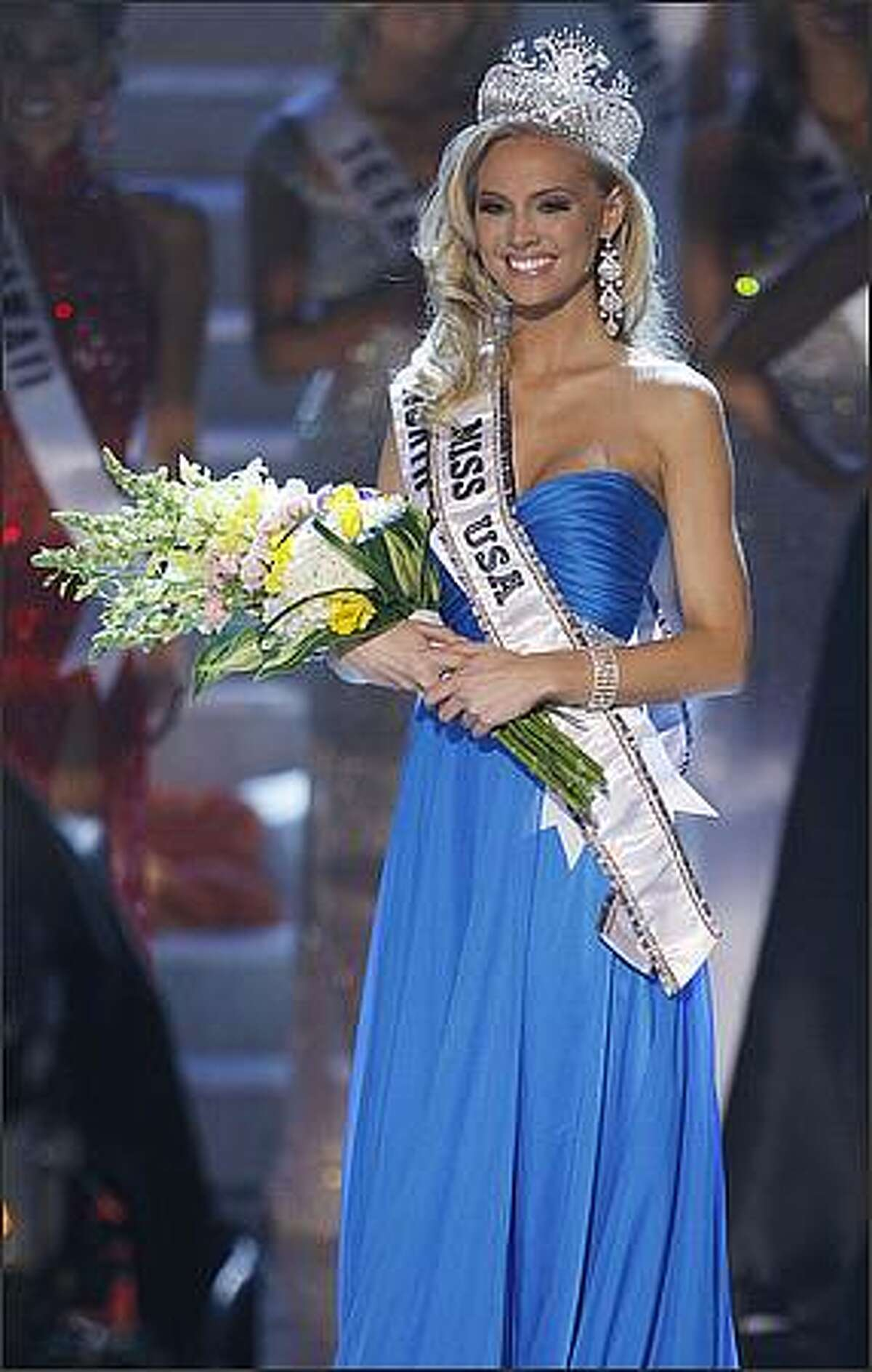 Miss North Carolina Kristen Dalton smiles after being crowned Miss USA on Sunday in Las Vegas. (AP Photo/Eric Jamison)