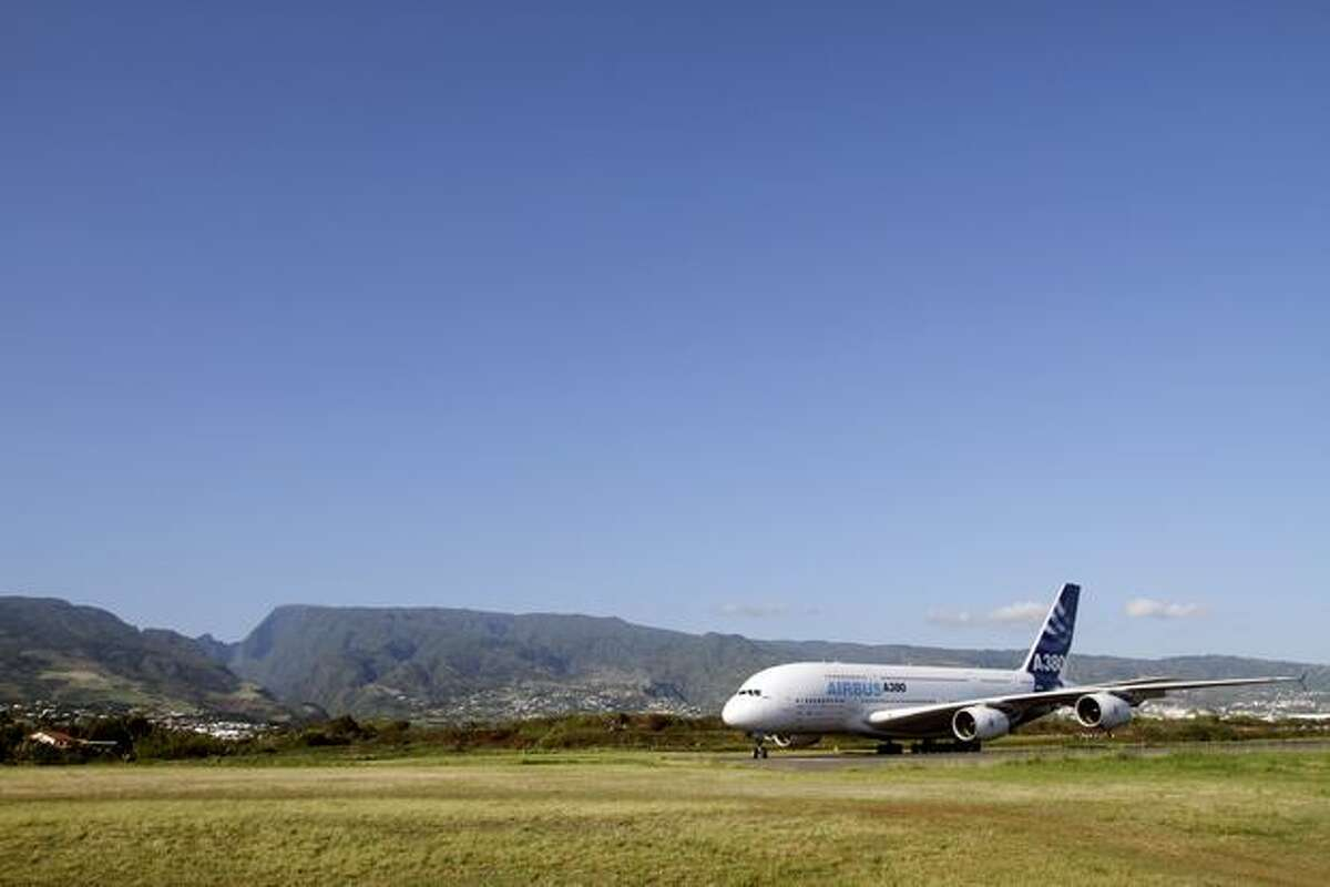 An Airbus A380 lands at the Roland-Garros airport near the city of Saint-Denis-de-la-Reunion after an exhibition flight over the Indian ocean island of La Réunion on November 11, 2009. The local airline company Air Austral has ordered two of the aircraft.