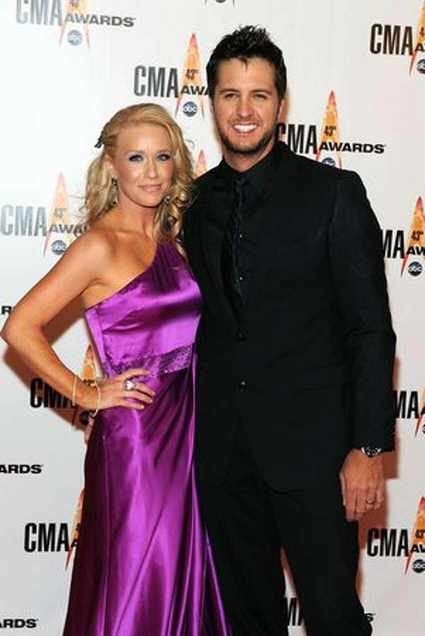 Caroline Bryan and singer Luke Bryan arrive.