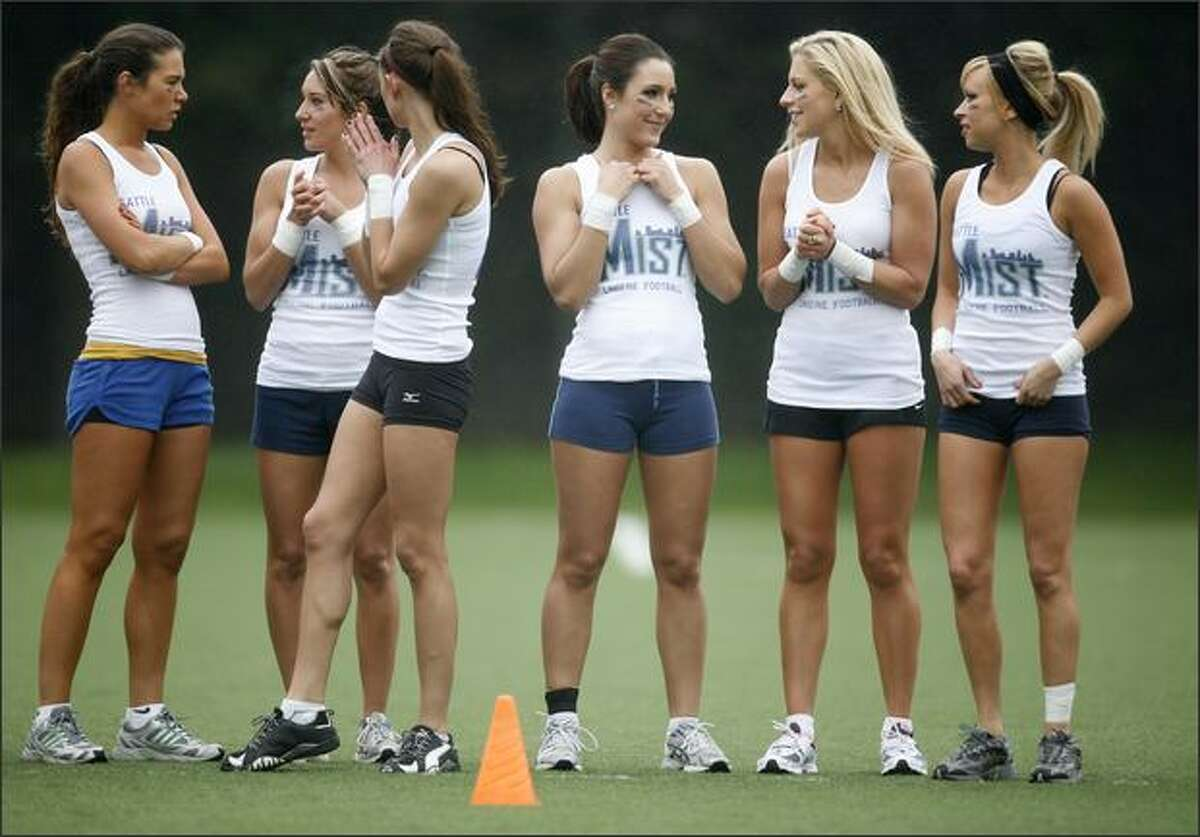 Members of the Seattle Mist, of the Lingerie Football League, participate in a mini-camp on Wednesday at the Starfire Sports Complex in Tukwila.