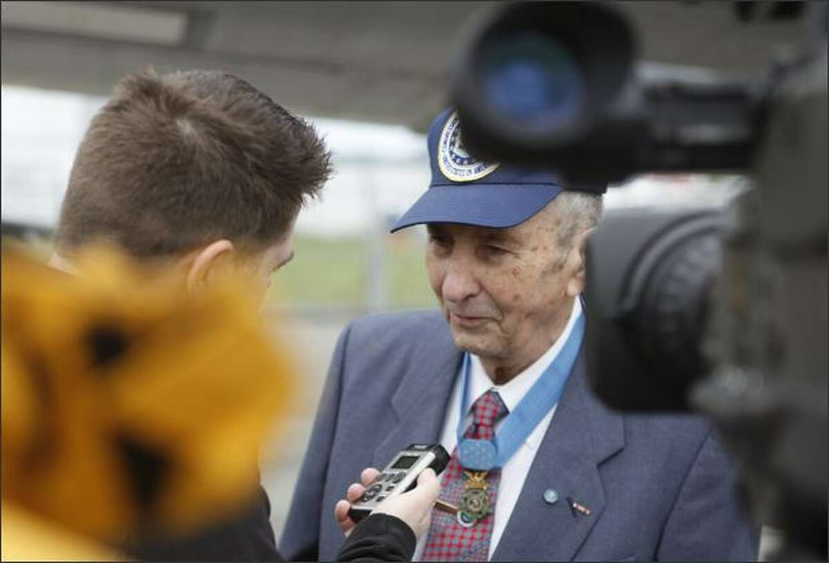 Medal of Honor recipient Pvt. Wilburn K. Ross is interviewed by media before a flight on the Liberty Belle, a 1945 B-17 bomber restored by the Liberty Foundation.