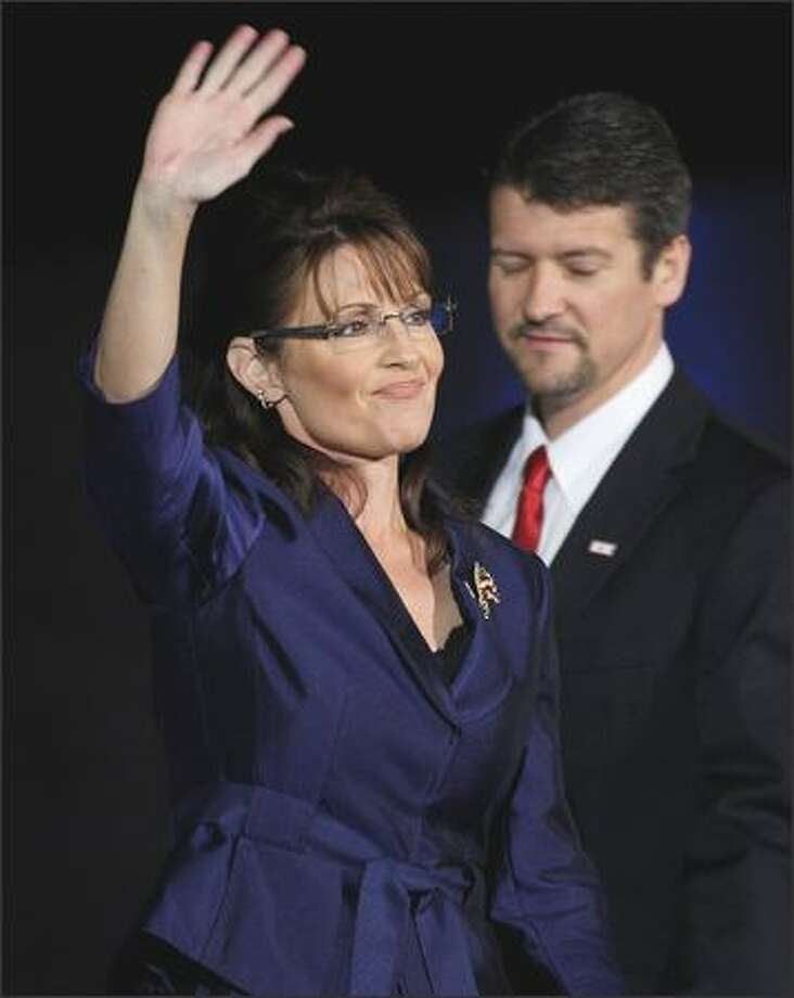 Vice-presidential nominee Alaska Gov. Sarah Palin and husband Todd Palin walk out on stage during 2008election night rally at the Arizona Biltmore Resort & Spa in Phoenix. The couple has split after 31 years of marriage. Photo: Getty Images