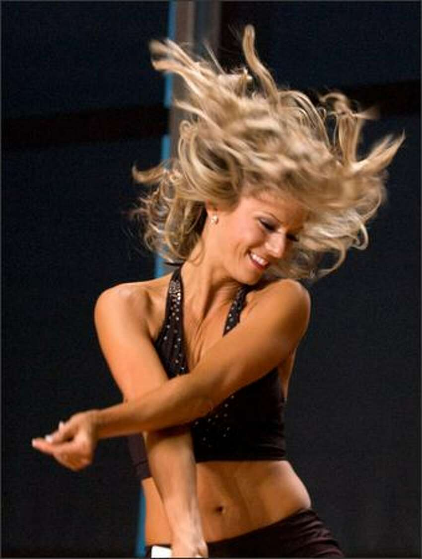 A participant competes during final tryouts for the Sea Gals at Qwest Field Sunday. (Daniel Berman / Special to SeattlePI.com)
