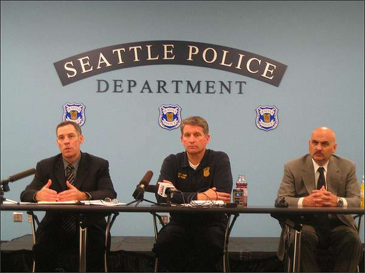 Seattle Police Gang Unit Lt. Ron Wilson, Assistant Chief Jim Pugel and Capt. Dave Emerick, who oversees the Violent Crimes Unit, discuss gang issues Friday at Seattle Police Headquarters.