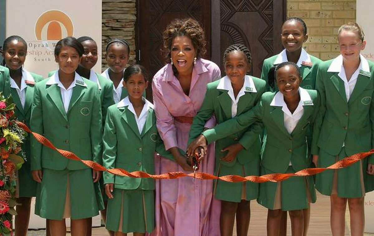 US television talkshow queen Oprah Winfrey (C) opens a multi-million dollar school for poor South African girls she has funded, January 2, 2007 in Johanesbourg. Winfrey's school was the culmination of a pledge she made to South Africa's anti-apartheid icon Nelson Mandela.
