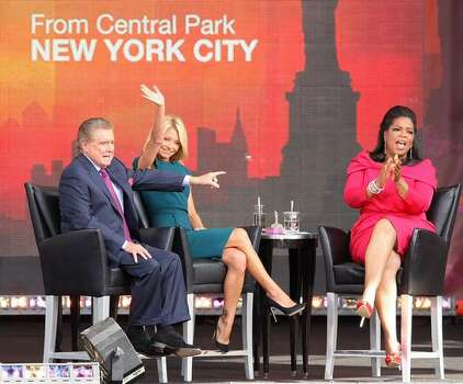 TV personalities Regis Philbin, Kelly Ripa and Oprah Winfrey appear on The Oprah Winfrey Show: Fridays Live From New York at Rumsey Playfield on September 18, 2009 in New York City. Photo: Getty Images