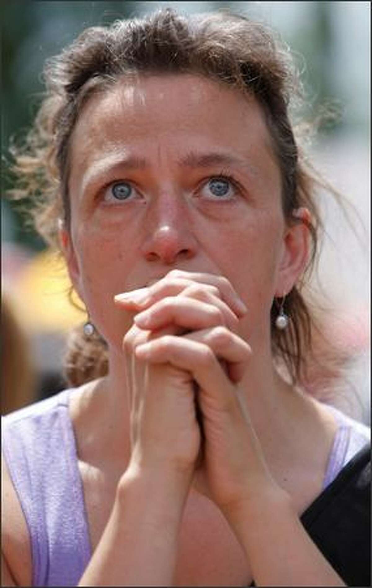 Seattle resident Jen Vetrovs tears up while hearing a story about a young boy's mother who died.