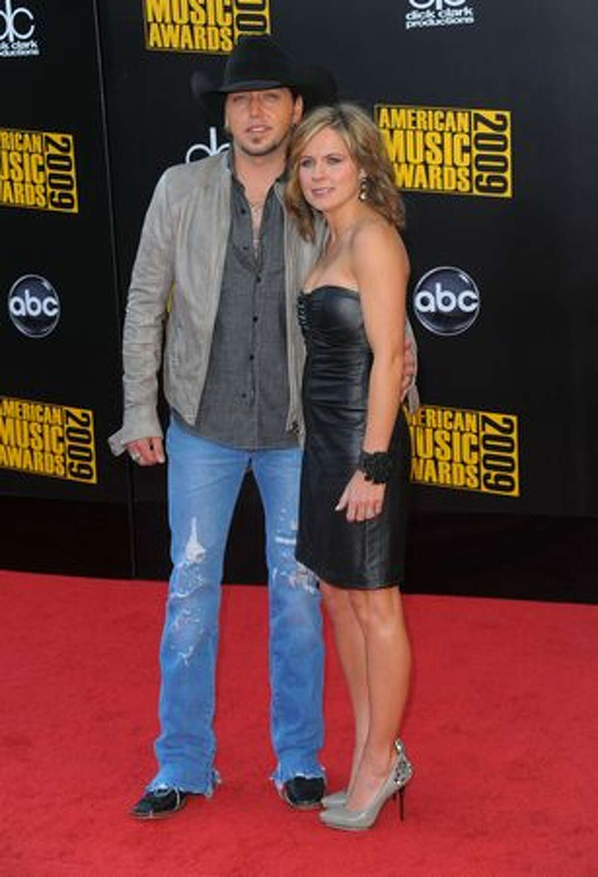 Singer/songwriter Jason Aldean (left) and Jessica Aldean arrive.