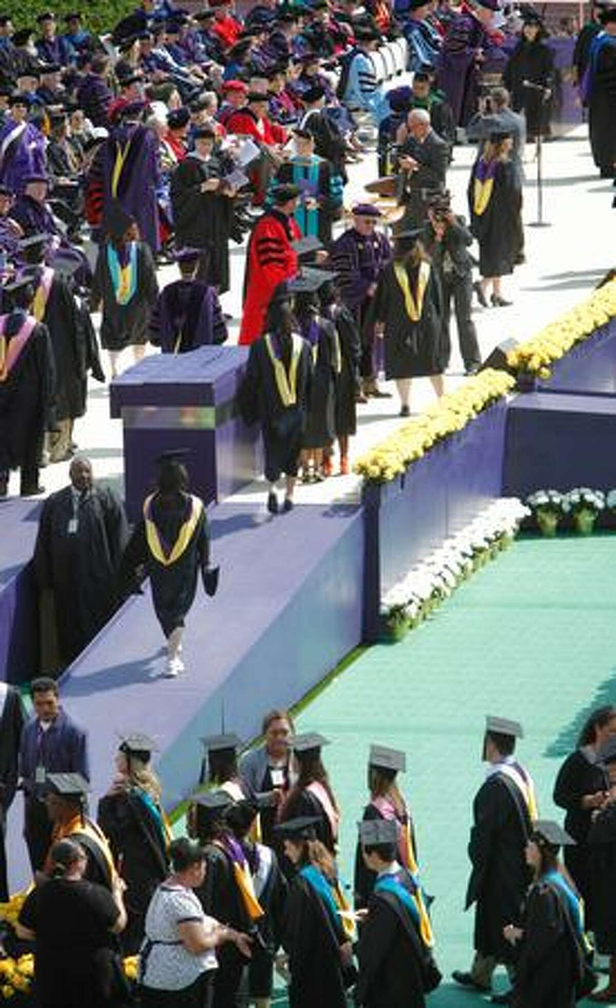 Masters students receive their degrees.