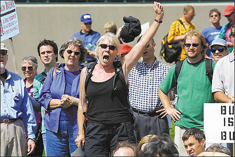 Katherine Bellows adds her voice to the throng protesting the president's policies, during a rally at Victor Steinbrueck Park, just north of Pike Place Market. Photo: Grant M. Haller, Seattle Post-Intelligencer