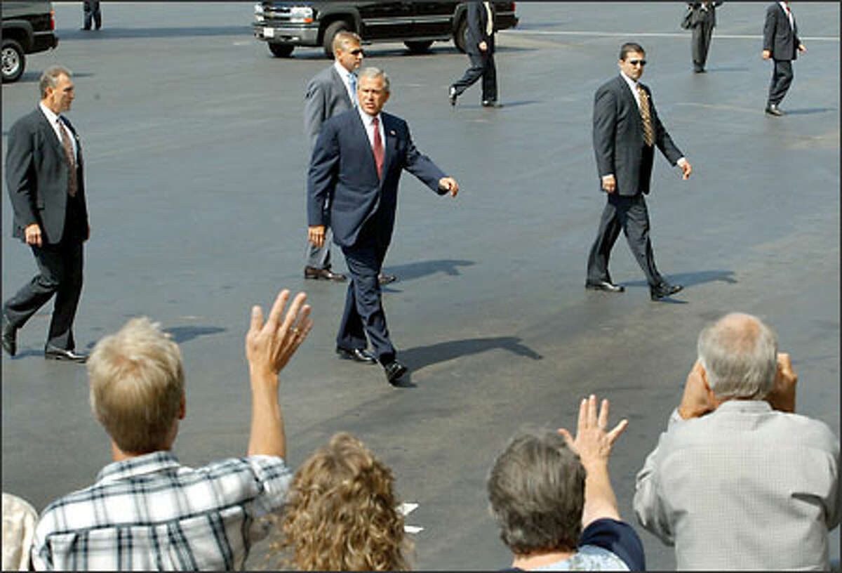 A select group of supporters greets President Bush as he arrives at Boeing Field at noon.