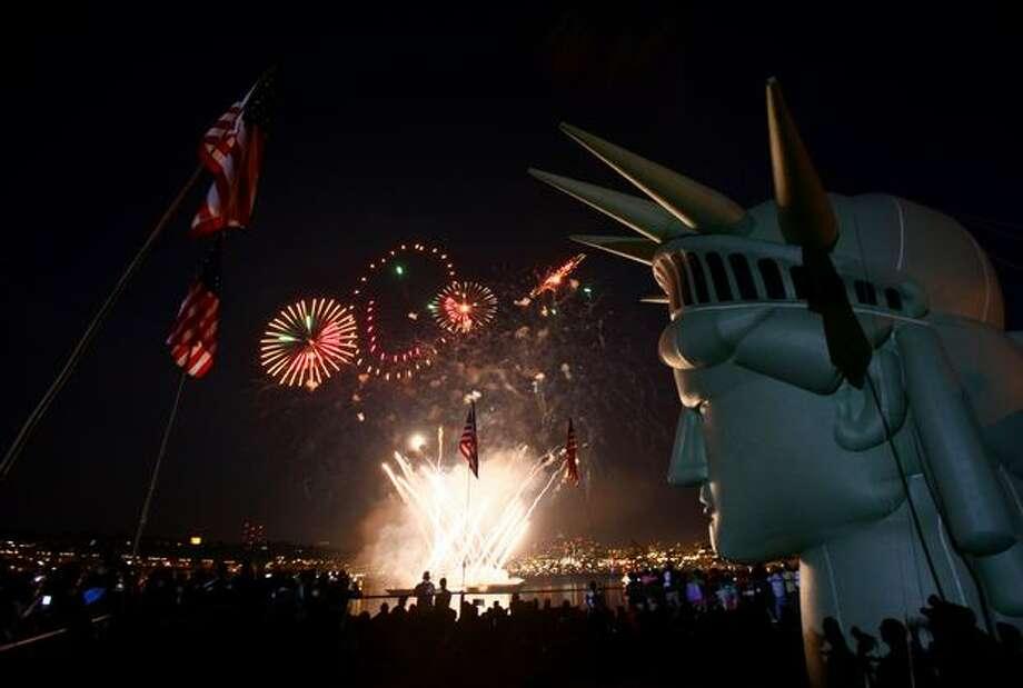 Fireworks explode above Lake Union. Photo: Joshua Trujillo, Seattlepi.com