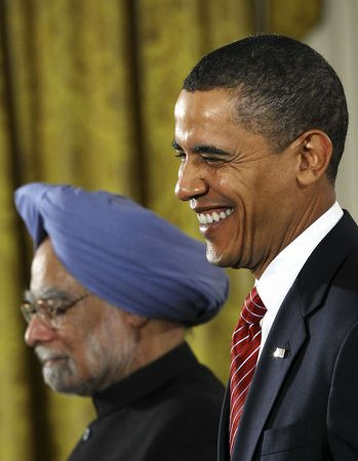 Indian Prime Minister Manmohan Singh and U.S. President Barack Obama participate in a joint press conference in the East Room of the White House.