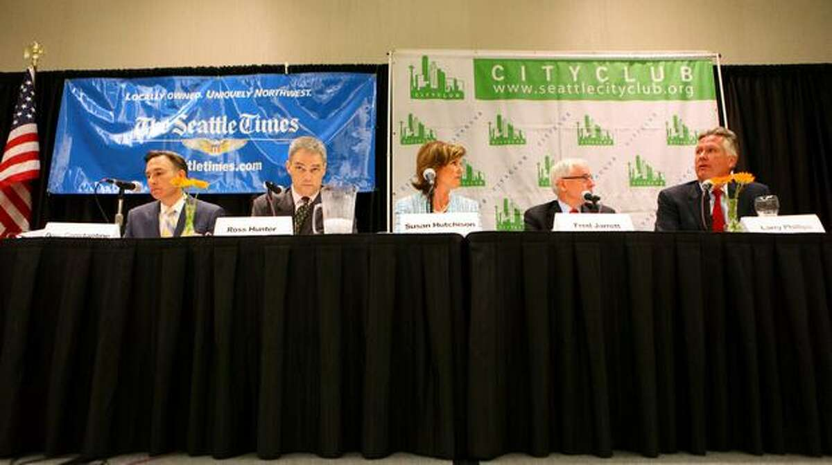 King County Executive candidates, from left, Dow Constantine, Ross Hunter, Susan Hutchison, Fred Jarrett and Larry Phillips participate in a debate for the executive position sponsored by CityClub and The Seattle Times at Meydenbauer Center in Bellevue on Thursday.