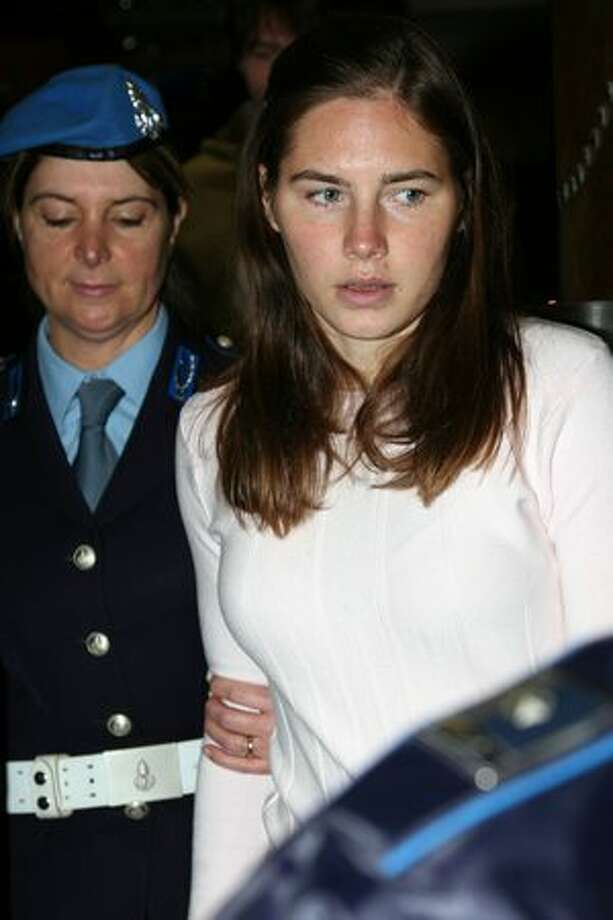 Amanda Knox arrives at the Perugia courthouse for the civil parties summing up of the Meredith Kercher murder trial Friday in Perugia, Italy. Amanda Knox and her former Italian boyfriend Raffaele Sollecito have been charged with the murder of British student Meredith Kercher on November 1, 2007 in Italy. Photo: Getty Images