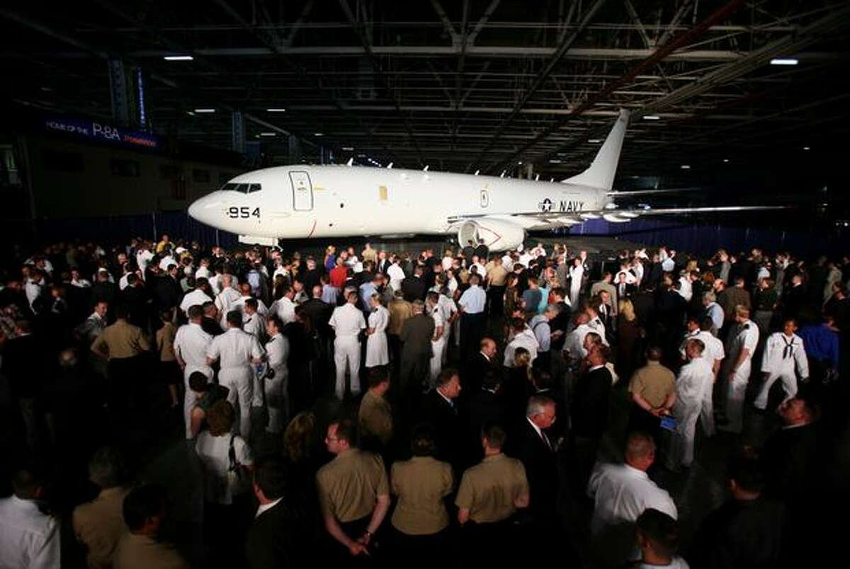 A crowd gathers around a new Boeing P-8A Poseidon during the rollout ceremony for the plane on Thursday July 30, 2009 at the Boeing plant in Renton.