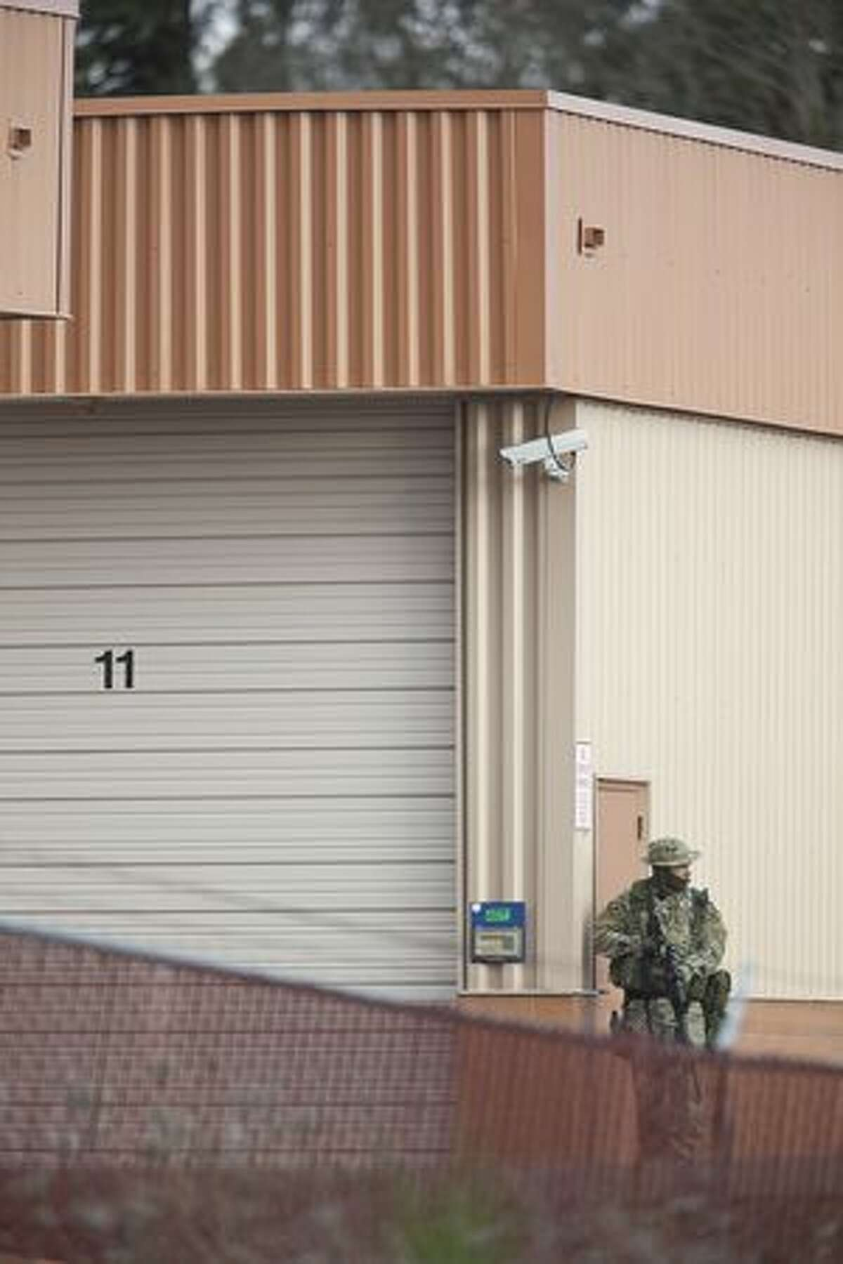 A SWAT team member takes part in the search of storage units near where four Lakewood Police Officers were killed Sunday near Lakewood. A gunman shot and killed four Lakewood Police Officers in a Forza Coffee Company shop Sunday morning in what authorities are describing as a targeted attack.