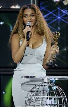 Beyonce collects her 'outstanding contribution to the arts' award onstage at the World Music Awards, held at the Sporting Club on Sunday in Monte Carlo, Monaco. Photo: Getty Images