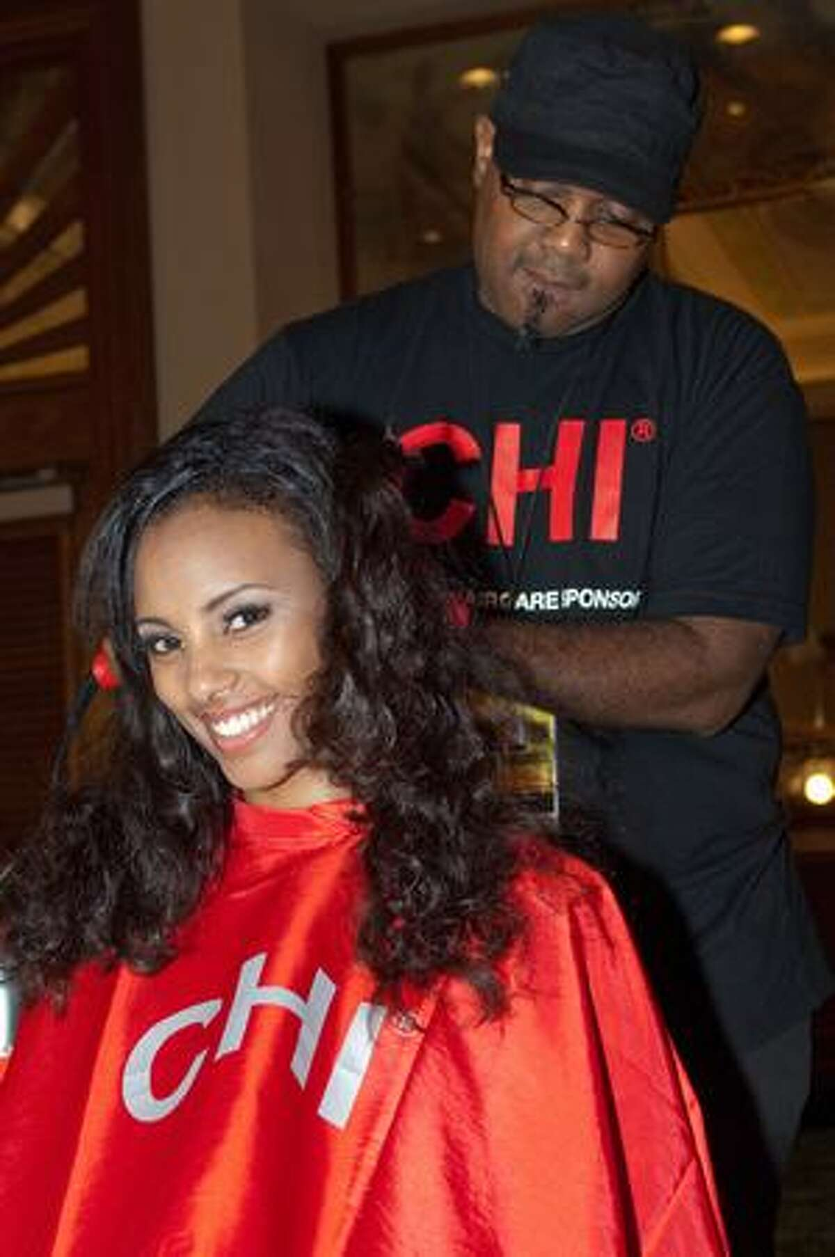Hairstylist Arthuro Gray works with Melat Yante, Miss Ethiopia.