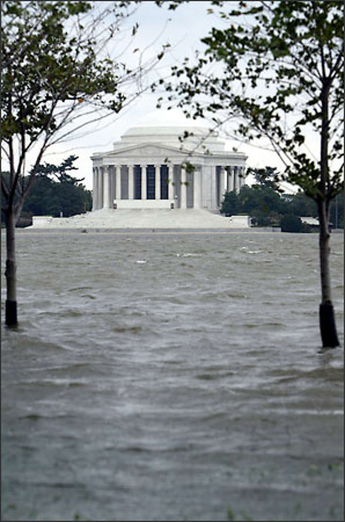 The overflowing Tidal Basin, across from the Jefferson Memorial, in Washington, D.C., in the aftermath of Hurricane Isabel. Thousands of residents were without lights, hundreds of trees littered the landscape, and all three branches of government were basically shut down. (AP Photo/Evan Vucci)