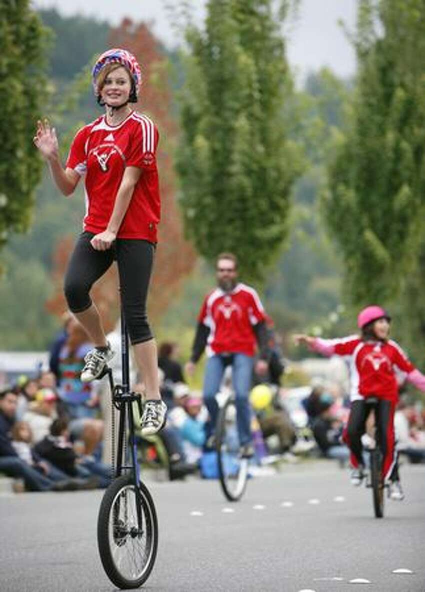 Members of Panther Pride Unicycle Team perform during the Issaquah Salmon Days Festival parade.