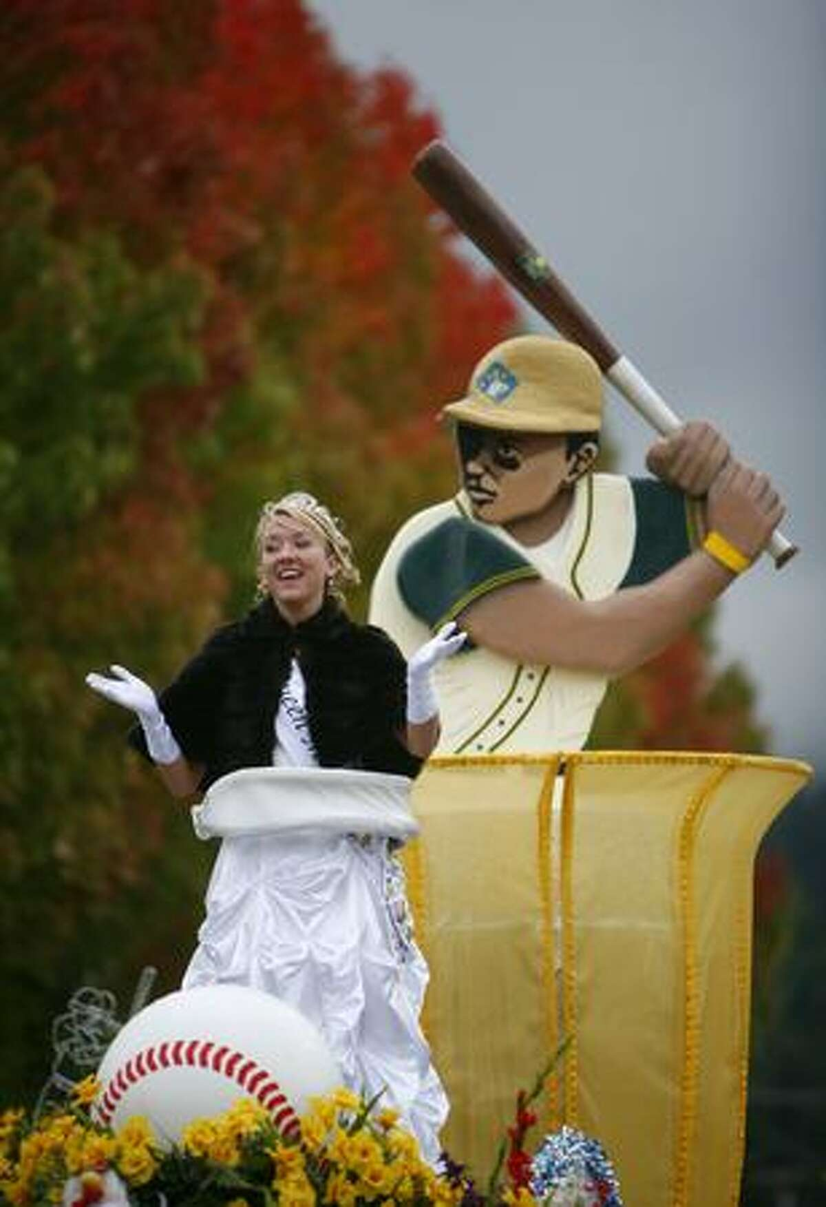 Members of the Daffodil Festival royalty ride in the Issaquah Salmon Days Festival parade.