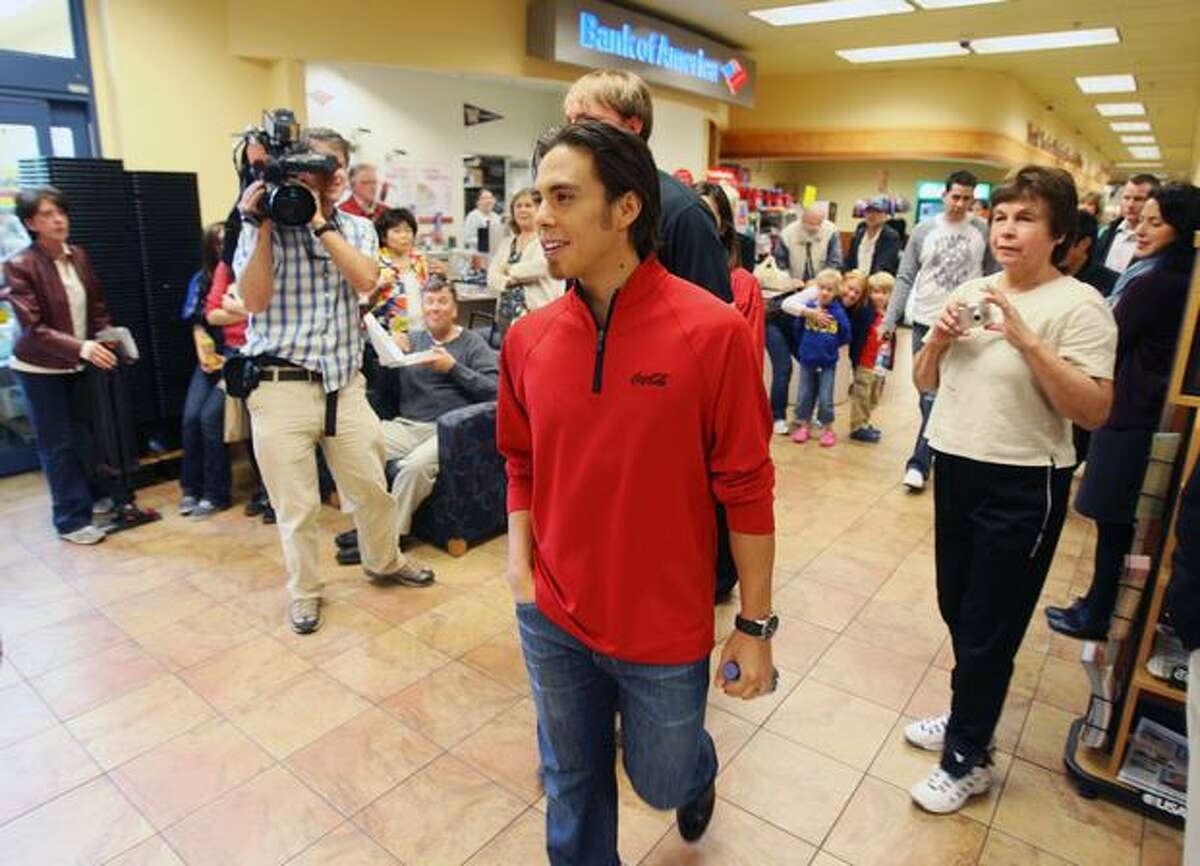Olympic speed skater Apolo Ohno arrives at the University Village QFC for the Olympic Winter Games promotional event by Coca-Cola Oct. 9.