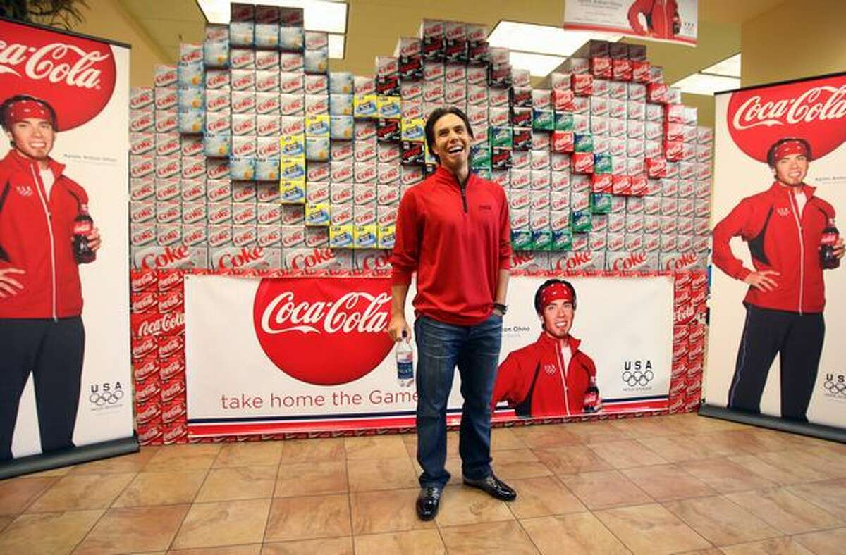 Five-time Olympic medalist Apolo Ohno waits to meet fans at the University Village QFC for the Olympic Winter Games promotional event by Coca-Cola Oct. 9.