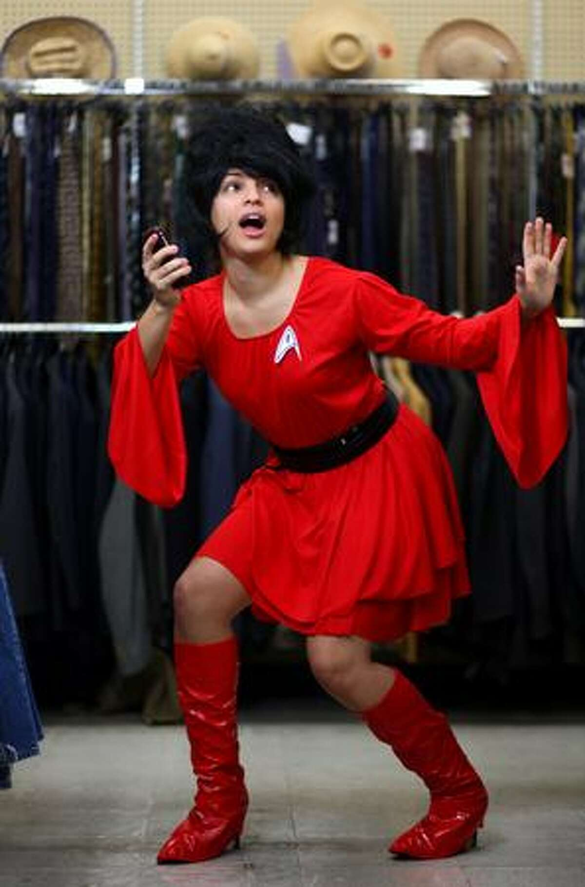 """""""Star Trek"""" -- Wig, $7.99; boot covers, $4.99; belt, $1.99; dress, $14.99. Photographed at Value Village in Seattle."""