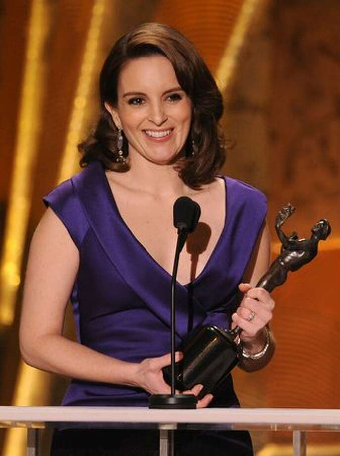 "Actress Tina Fey accepts the Female Actor In A Series award for ""30 Rock"" onstage. Photo: Getty Images"