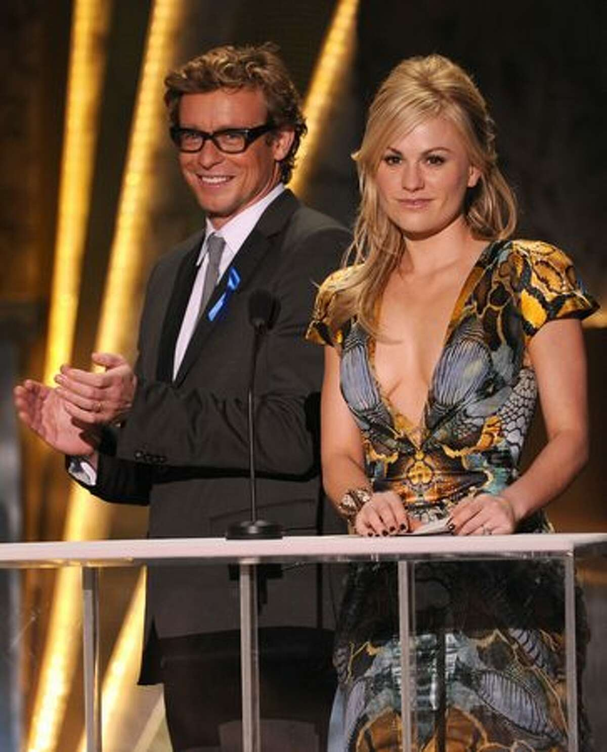 Actor Simon Baker actress Anna Paquin onstage.