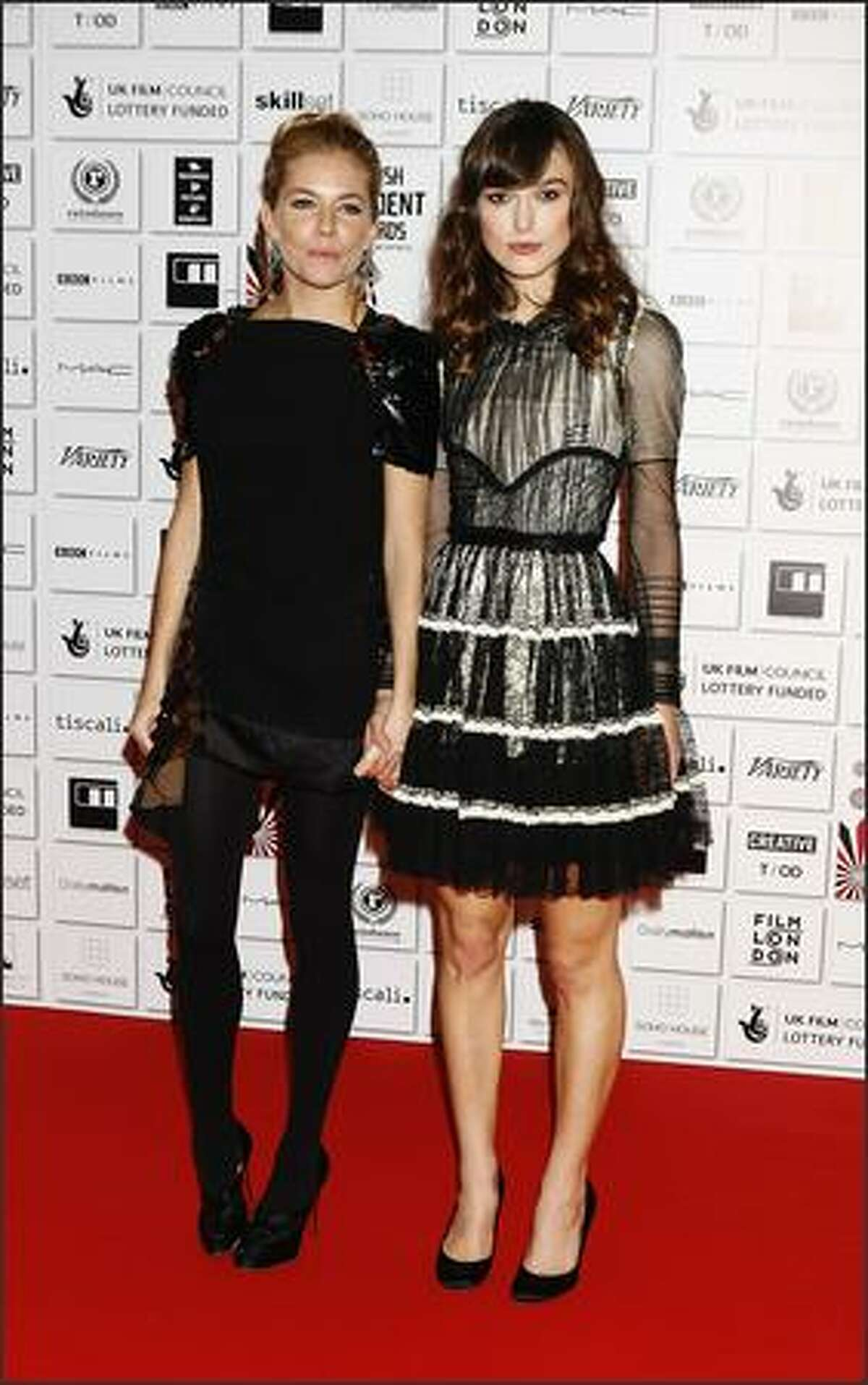 Sienner Miller and Keira Knightley arrive at the British Independant Film Awards 2008 at Old Billingsgate on Sunday in London.