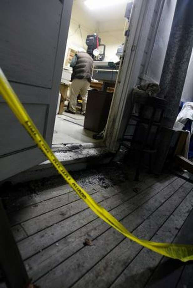 One of the small fires set Sunday night was at the base of the back door to Moonphoto, a business in the 7700 block of Greenwood Avenue North. The fire continues a string of Greenwood arsons. Photo: Casey McNerthney, Seattlepi.com