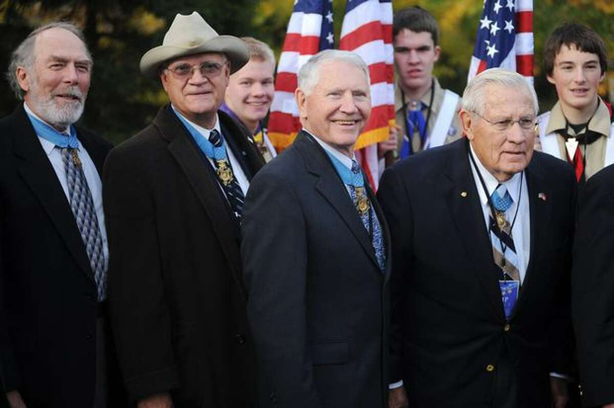 Medal of Honor recipients stand with members of the Boy Scouts of America Wednesday prior to the Medal of Honor Memorial dedication.