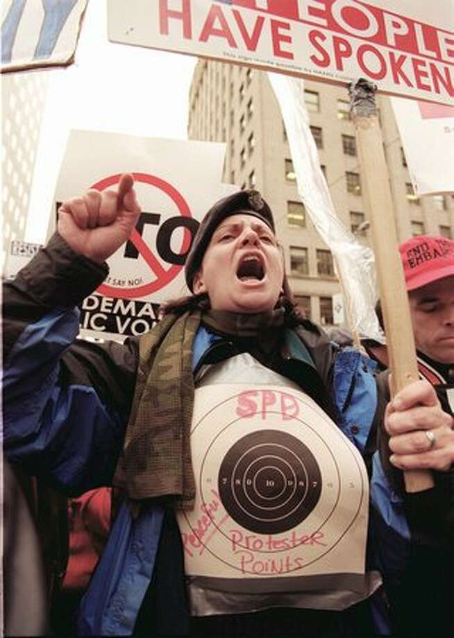 Jenee Gregory of Seattle yells at Seattle police officers during a WTO protest march on Dec. 3, 1999. (Photo by Rick Giase) Photo: Seattle Post-Intelligencer