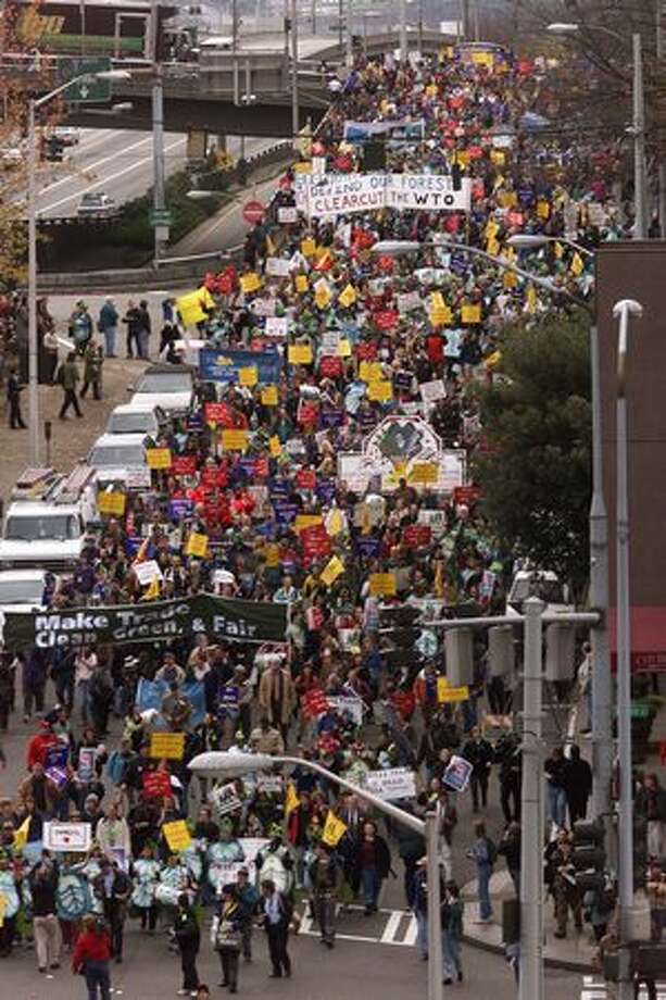 WTO protesters march down Sixth Avenue from Marion Street on their way to the Convention Center on Nov. 29, 1999. (Photo by Mike Urban) Photo: Seattle Post-Intelligencer