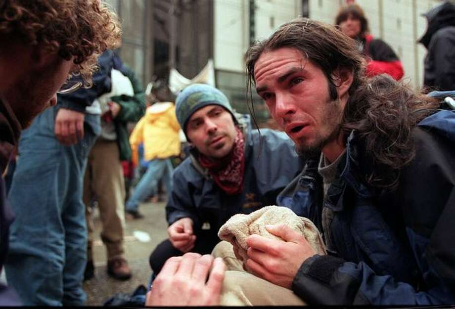 A protester recovers from tear gas during the WTO protest on Nov. 30, 1999. (Photo by Paul Joseph Brown) Photo: Seattle Post-Intelligencer