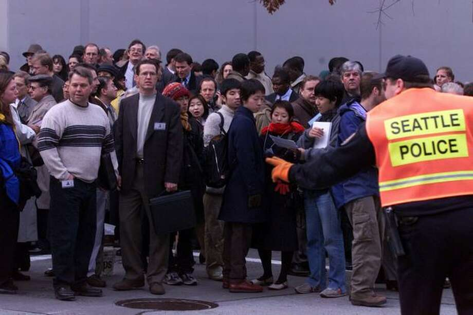 Journalists, delegates and dignitaries were denied access to the the Washington State Convention & Trade Center on Nov. 29, 1999, delaying the Non-Governmental Organizers symposium. (Photo by Dan DeLong) Photo: Seattle Post-Intelligencer