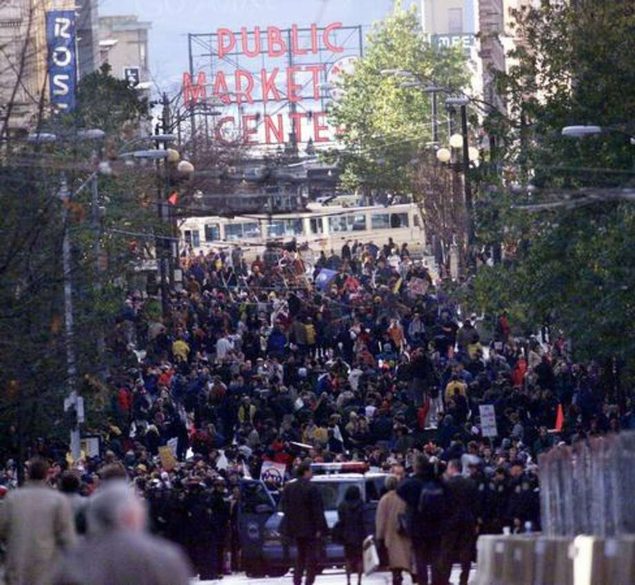 protesters gather on Pike Street on Nov. 30, 1999. (Photo by Grant M. Haller) Photo: Seattle Post-Intelligencer