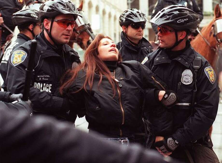 Cheri Honkala is arrested by Seattle Police after she tried to break through police lines outside the Washington State Trade & Convention Center on Nov. 29, 1999. Honkala and others tried to serve arrest warrants on the G7 Ministers. (Photo by Rick Giase) Photo: Seattle Post-Intelligencer