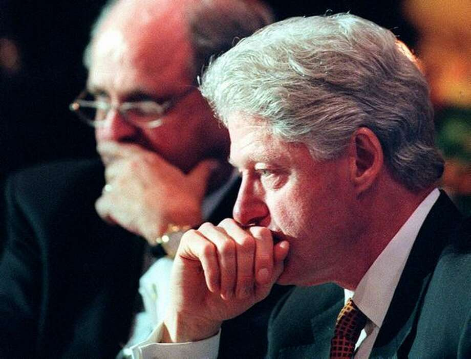 Director General of the WTO Michael Moore and President Bill Clinton participate in a luncheon for WTO delegates at the Four Seasons Olympic hotel in Seattle on Dec. 2, 1999. Both Moore and Clinton spoke forcefully on behalf of free trade. (Photo by Paul Joseph Brown) Photo: Seattle Post-Intelligencer
