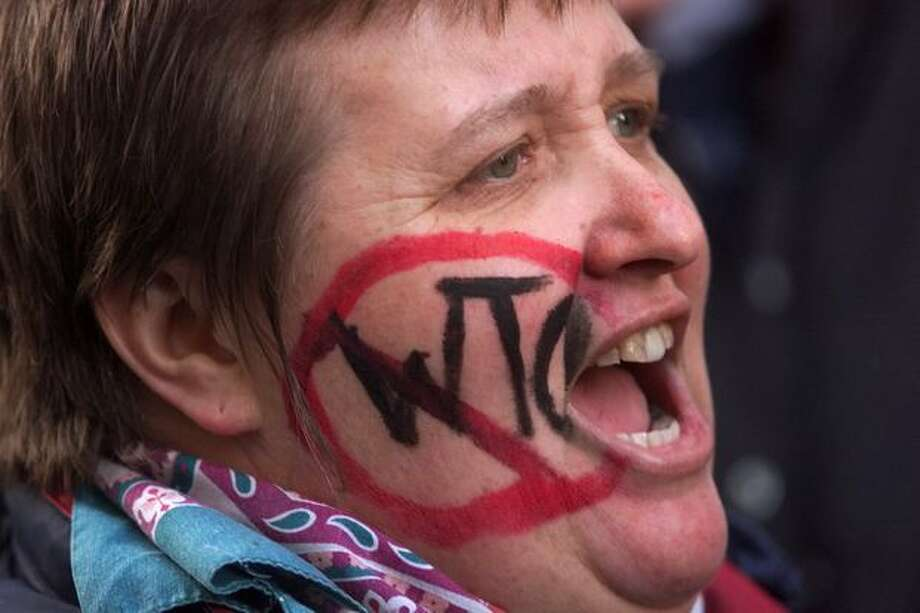 A woman wears her disapproval of the WTO on Nov. 30, 1999. Photo: Seattle Post-Intelligencer