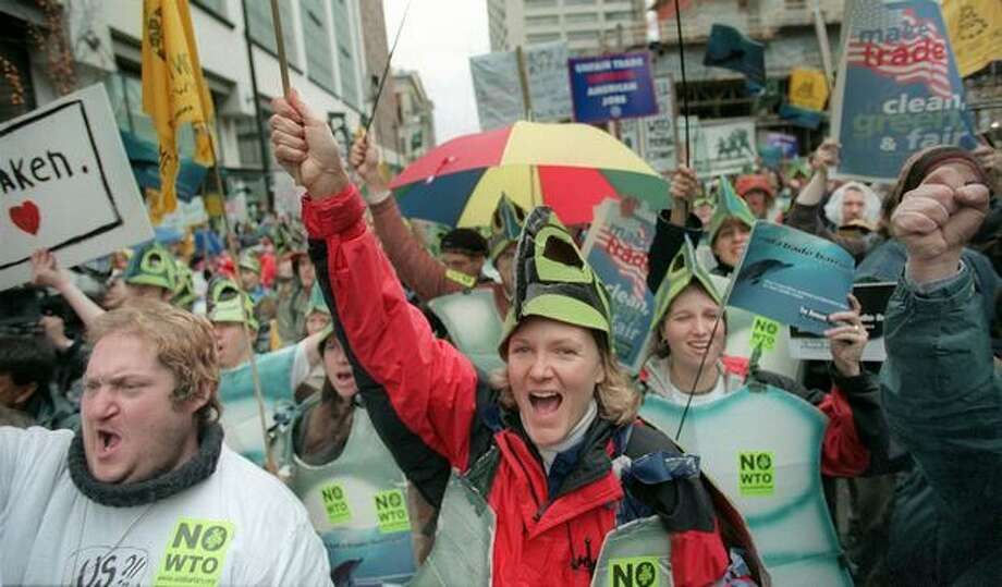 """Susan Oseth of Bainbridge Island was one of nearly 250 """"sea turtles"""" taking part in a march from the First Methodist Church to Eighth Avenue and Pine Street. Photo: Seattle Post-Intelligencer"""