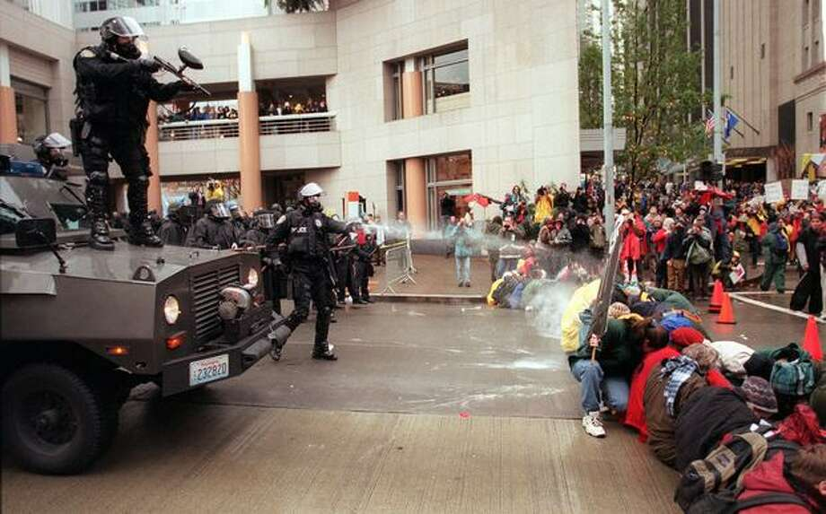 WTO demonstrators are hit with pepper spray as police try to disperse the crowd on Nov. 30, 1999. (Photo by Paul Joseph Brown) Photo: Seattle Post-Intelligencer