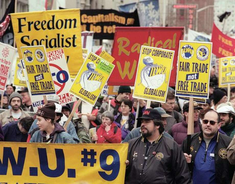 Union workers march in a parade through downtown Seattle on Dec. 03, 1999. (Photo by Rick Giase) Photo: Seattle Post-Intelligencer