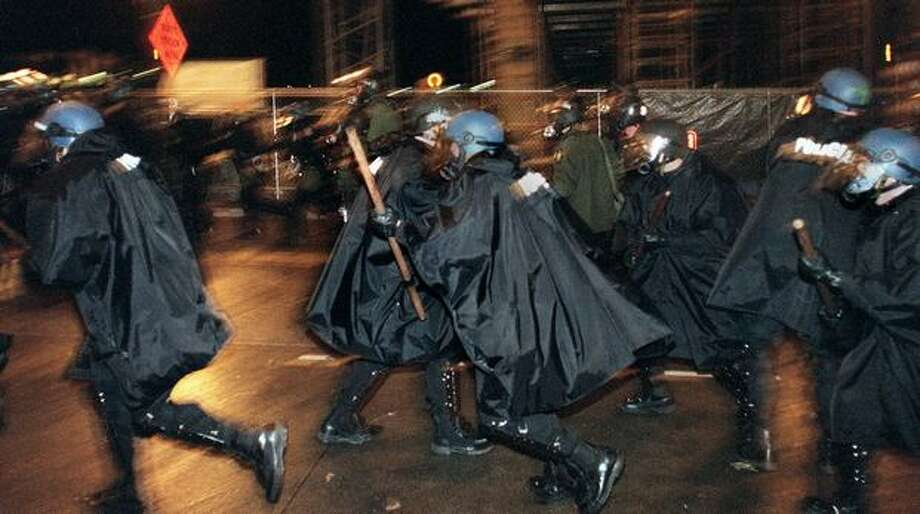 Police charge at WTO protesters on Nov. 30, 1999, as they regrouped on Capitol Hill after they were pushed east from the Paramount Theater. Photo: Seattle Post-Intelligencer